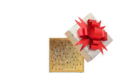 Gold gift box with red bow on white background Royalty Free Stock Photo