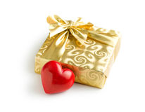 Gold gift box with red heart. On white background Stock Images