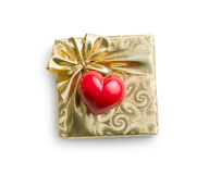 Gold gift box with red heart. On white background Royalty Free Stock Photo