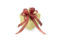 Gold gift box with red ribbon Royalty Free Stock Photo