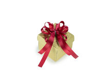 Gold gift box with red ribbon Stock Photography