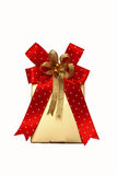Gold gift box with red ribbon on white. Royalty Free Stock Images