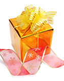 Gold gift box with ribbon Royalty Free Stock Photos