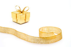 Gold gift box with the ribbon Stock Photos