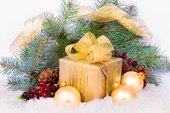 Gold gift box with ribbon and bow . Royalty Free Stock Images