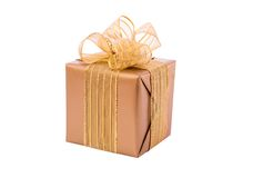 Gold gift box with ribbon and bow Royalty Free Stock Photo