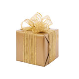 Gold gift box with ribbon and bow. Present Royalty Free Stock Photo