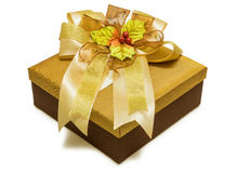 Gold gift box with ribbon Royalty Free Stock Images