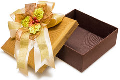 Gold gift box with ribbon Stock Photos