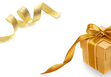 Gold gift box with Shiny gold satin ribbon Stock Photos