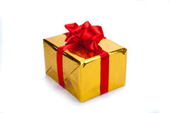 Gold gift box. On white background Royalty Free Stock Photography