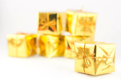 Gold gift box. Royalty Free Stock Photo