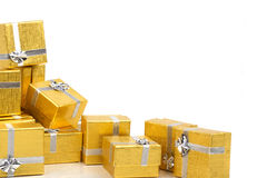 Gold gift boxes. On white background Royalty Free Stock Photography