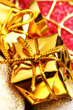 Gold gift boxes Royalty Free Stock Images