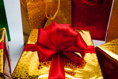 Gold gift boxes. Gold gift box on white background Stock Photography