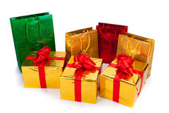 Gold gift boxes and gift Bags. Three gold gift boxes and gift Bags on white background Royalty Free Stock Photography