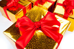 Gold gift boxes. Macro white Royalty Free Stock Photography