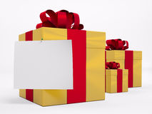 Gold gift boxes with red ribbon 3d. Gold gift boxes with red ribbon and blank sheet of paper 3d Royalty Free Stock Photos