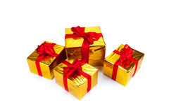 Gold gift boxes. On white background Stock Photography