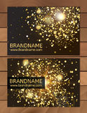 Gold Gift Business card template with abstract pattern, glitter dust, sparkling, twinkling stars. Cosmic atmosphere background, un Royalty Free Stock Image