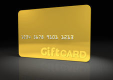 Gold Gift Card. On Black reflective surface (includes clipping path Stock Image