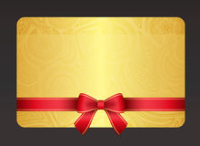 Gold gift card with red ribbon and vintage floral Royalty Free Stock Photo