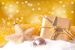 Gold gift with Christmas ball Stock Images