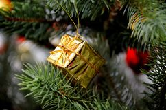 Gold gift. Christmas tree toy. Royalty Free Stock Photography