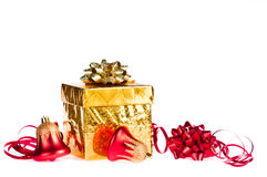 Gold gift with colorful decorations Stock Image