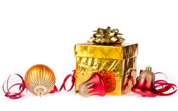 Gold gift with colorful decorations Stock Images