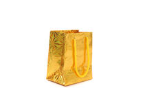 Gold gift parcel. Isolated on white Stock Images