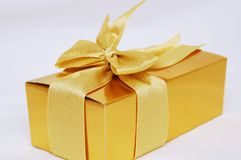 Gold gift present isolated. Christmas gift present with white background royalty free stock image