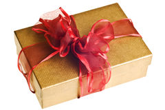 Gold gift with red bow Stock Photography