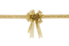 Gold gift ribbon and bow, isolated on white background. Royalty Free Stock Images