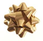 Gold Gift Ribbon Rosette On White Stock Image