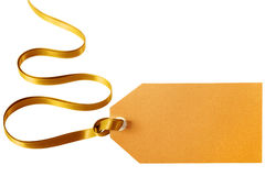 Gold gift tag. Tied with curly ribbon isolated on white Royalty Free Stock Photos