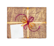 The gold gift which is elegantly packed Royalty Free Stock Images