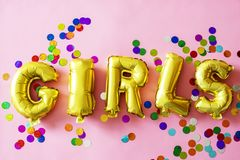 Gold Girls Letter Balloons on Pink Surface Stock Images