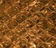 Gold glass texture with a pattern of rhombuses. Clear glass diamond shape. Crystals Royalty Free Stock Image