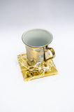 Gold Glass  on white Royalty Free Stock Photography