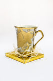 Gold Glass  on white Royalty Free Stock Photo
