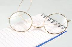 Gold glasses Stock Photos