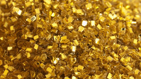 Gold glitter. Close up of gold glitter Royalty Free Stock Photography