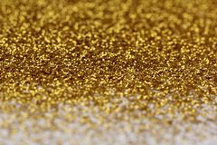 Gold glitter abstract background. With blurry edges stock images