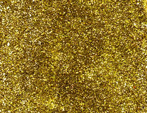 Gold glitter background. A macro close up of a gold glitter background Stock Images