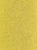 A gold glitter background for any purpose. A gold glitter shiny background for any purpose Royalty Free Stock Image