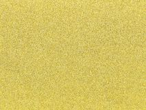 A gold glitter background as an abstract texture.  Stock Photography