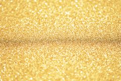 Gold and glitter background with narrow focus. Gold Dust. Gold and glitter background. Gold Dust texture background with narrow focus so can be used for beauty stock photo