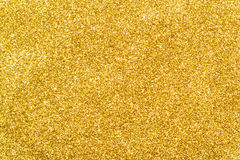 Gold glitter background sparkling sequin. Festive texture for your design Stock Photos