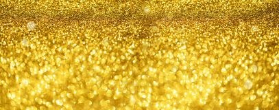 Gold glitter banner. Shiny abstract textured background with golden lights, bokeh. Christmas, new year concept with copy space for stock photography